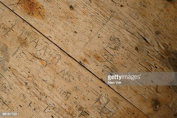 Detail of inscriptions in a wooden table