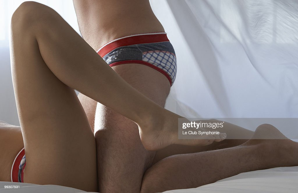 Detail of intimate young couple in bed : Stock Photo