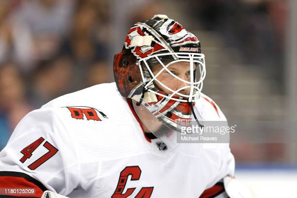 A detail of James Reimer of the Carolina Hurricanes mask against the Florida Panthers during the first period at BBT Center on October 08 2019 in...