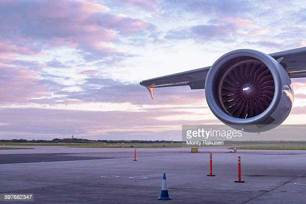 Detail of jet engine of A380 aircraft at sunset