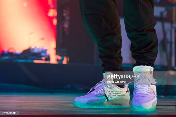 Detail of John Mayer wearing Virgil Abloh's OffWhite x Nike footwear while performing during The Search For Everything Wolrd Tour at Smoothie King...