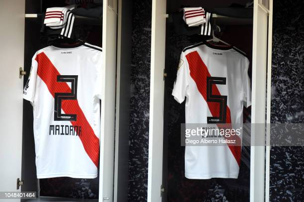 Detail of Jonatan Maidana and Bruno Zuculini of River Plate jersey in the dressing room prior to a match between a quarter final second leg match of...