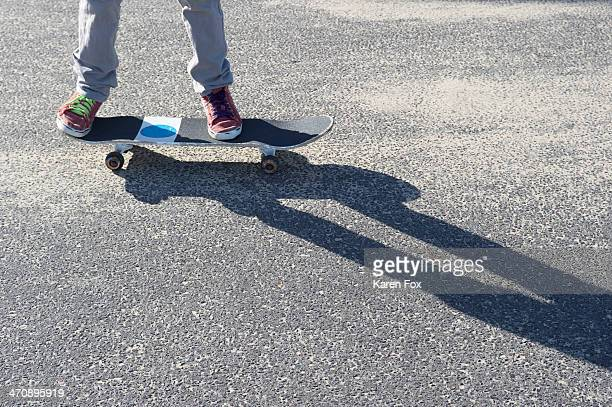 Detail of legs riding skateboard