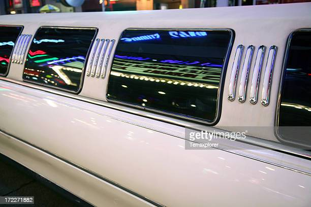 Detail Of Limousine With Neon Reflections