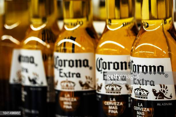 Detail of lined up Corona beer bottles seen on the store shelf Corona extra Lager Beer is the flagship product of the Mexican company Grupo Modelo