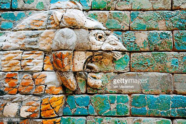 detail of lion on wall at pergamon museum - ishtar gate stock photos and pictures