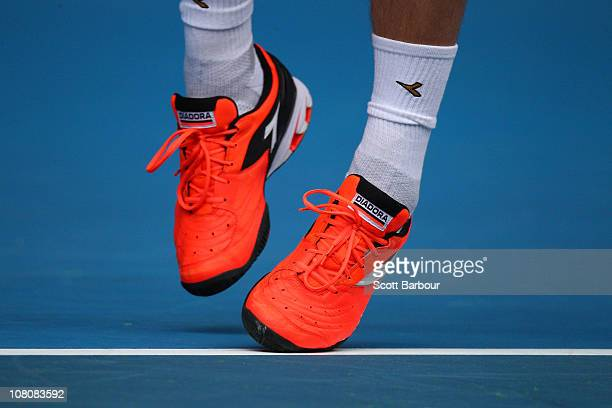 Detail of Lukas Lacko's shoes during his first round match against Roger Federer during day one of the 2011 Australian Open at Melbourne Park on...