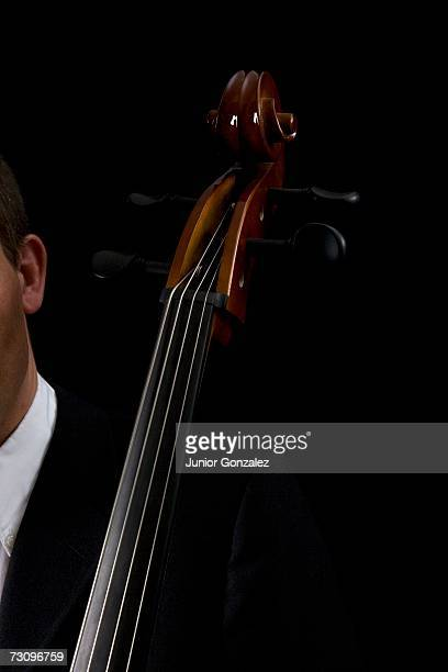 detail of man playing the cello - cellist stock pictures, royalty-free photos & images