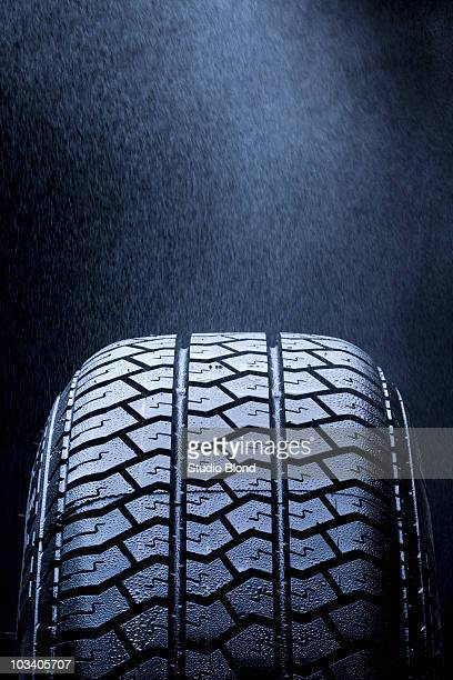 Detail of mist falling on a car tire
