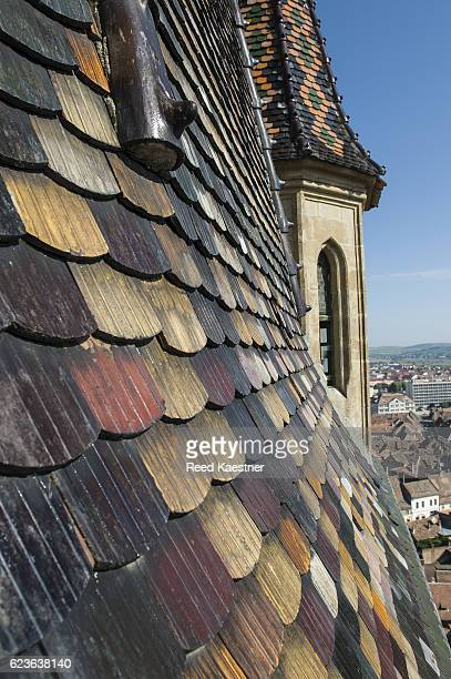 Detail of multi colored roof tiles on the steeple of the Sibiu Lutheran Cathedral