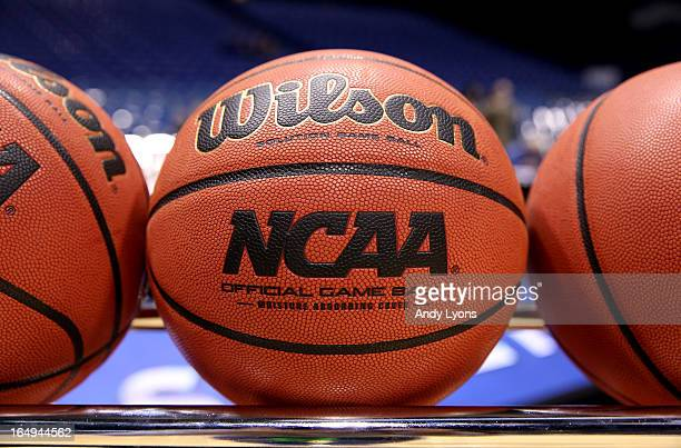A detail of NCAA Official Wilson basketballs are seen racked up on the court prior to Oregon playing against Louisville during the Midwest Region...