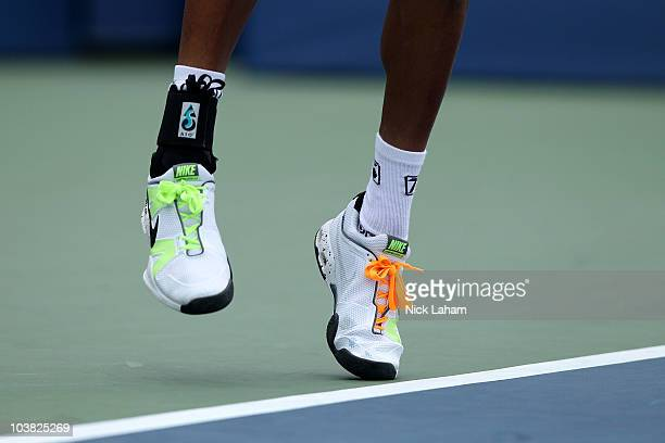 A detail of Nike tenis shoes worn by Dustin Brown of Jamaica as he serves against Andy Murray of Great Britain during his men's singles match on day...