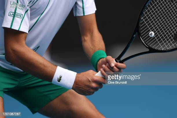 Detail of Novak Djokovic of Serbia racquet as he prepares to return a serve during his Men's Singles second round match against Tatsuma Ito of Japan...