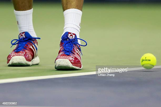 A detail of Novak Djokovic of Serbia shoes as he serves against JoWilfried Tsonga of France during the men's singles final match of the Shanghai...
