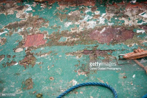 Detail of old green wood and ropes of a fishing boat in Galicia, Spain