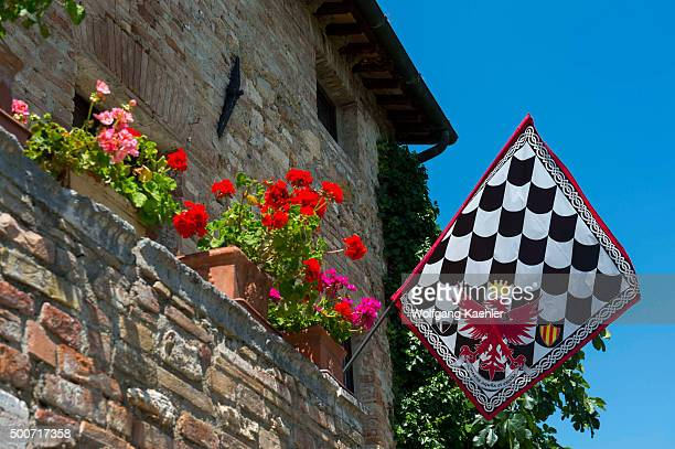 Detail of old house with flag in Bagno Vignoni, a small spa of medieval origin which was already know in Roman times, is located near San Quirico in...