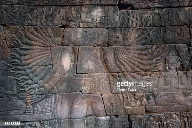 Detail of one of the eight Lokeshvaras multiarms Buddhist deities depicted on a basrelief wall of Banteay Chhmar temple In Cambodia this type of...