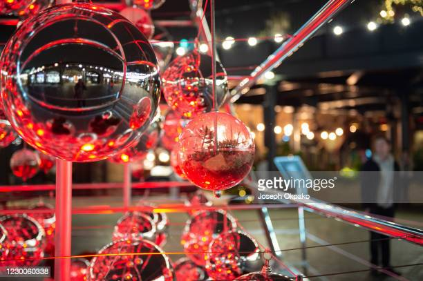 Detail of one of the glass terrariums that make up Coal Drops Yard 28-feet tall Christmas tree structure on December 10, 2020 in London, England....