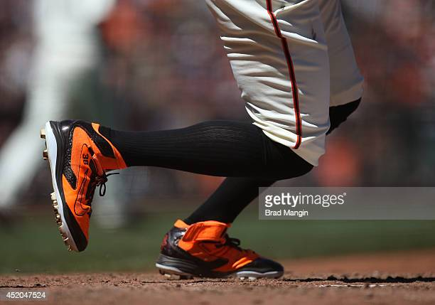 Detail of orange and black Nike cleats belonging to Michael Morse of the San Francisco Giants while batting during the game against the Oakland...