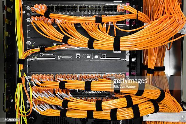 detail of orange cables in a server room. - arame imagens e fotografias de stock