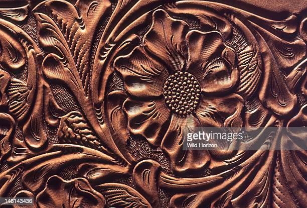 Detail of ornate floral and leaf tooled leather design on saddle made by famous New Mexico saddlemaker Austin Green known as Slim by his friends...