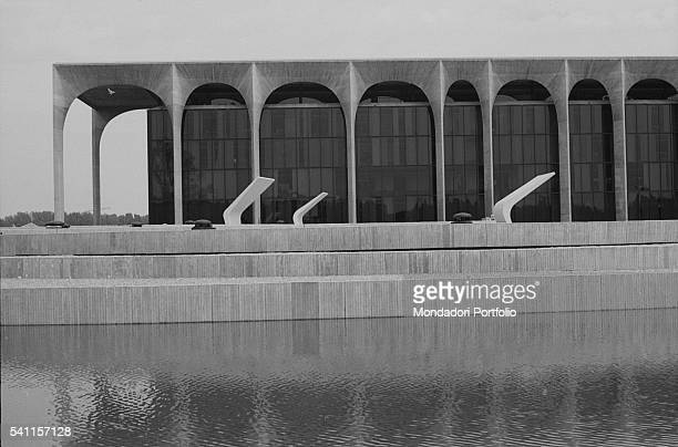 A detail of Palazzo Mondadori with its signature arcades designed by Brazilian architect Oscar Niemeyer In the foreground we can see an artificial...