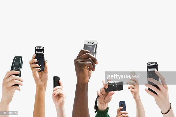 Detail of people with raised hands and holding mobile phones