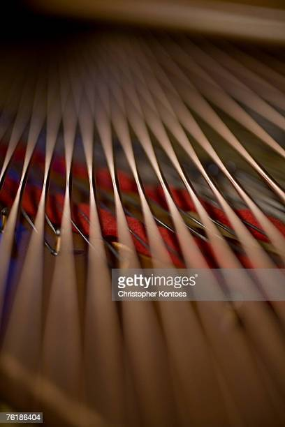 detail of piano strings - grand piano stock photos and pictures