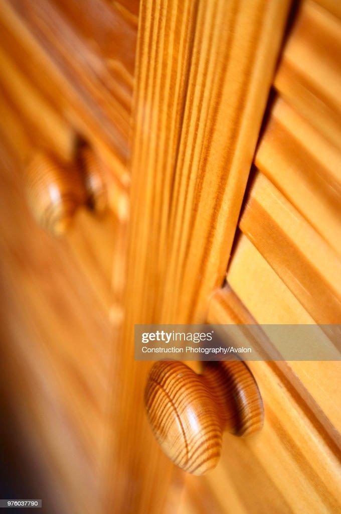 Detail Of Pine Door Knobs On Closed Panel Louvre Doors.