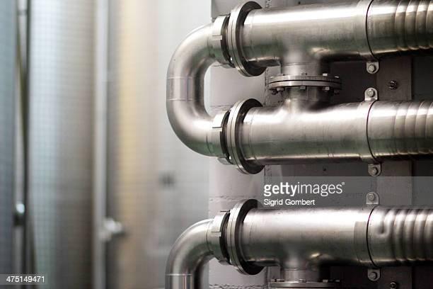 detail of pipes in industrial wine cellar - sigrid gombert stock-fotos und bilder