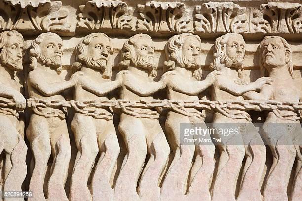 Detail of prisoners in the portal of St.Trophime, Place de la Republique, Arles, Provence