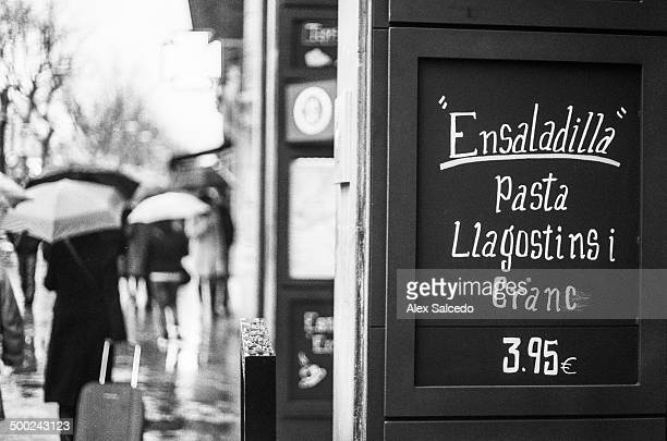 CONTENT] Detail of pub chalkboard in a rainy afternoon Black and white film source