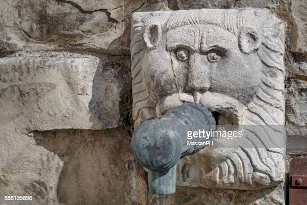 Detail of public fountain in the shape of a lion's head