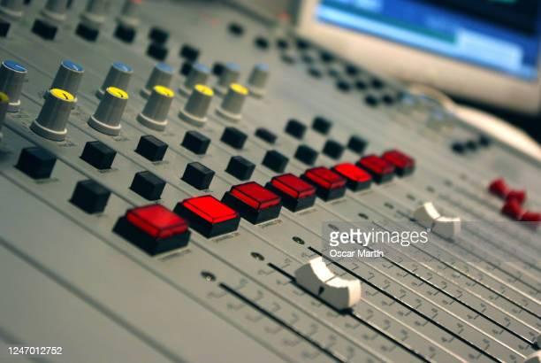 detail of radio station sound control table - equalizer stockfoto's en -beelden