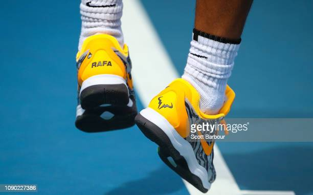 A detail of Rafael Nadal of Spain shoes as he serves during a practice session ahead of his Men's Singles Final match against Novak Djokovic of...