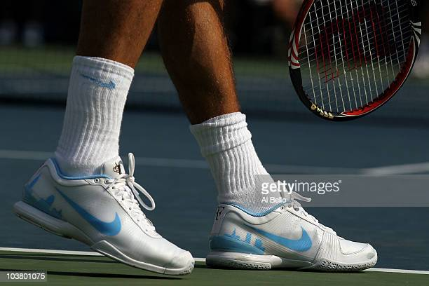 A detail of Roger Federer of Switzerland sneakers are seen as he plays against Andreas Beck of Germany during the Men's singles on day four of the...