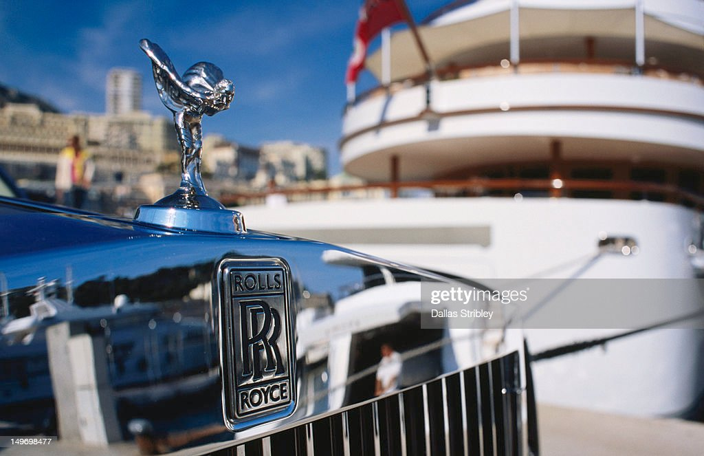 Detail of Rolls Royce parked in front of luxury yacht, Port Hercule. : Stock Photo