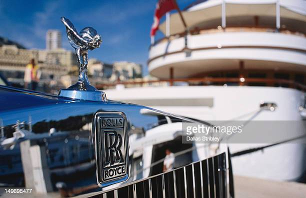 Detail of Rolls Royce parked in front of luxury yacht, Port Hercule.