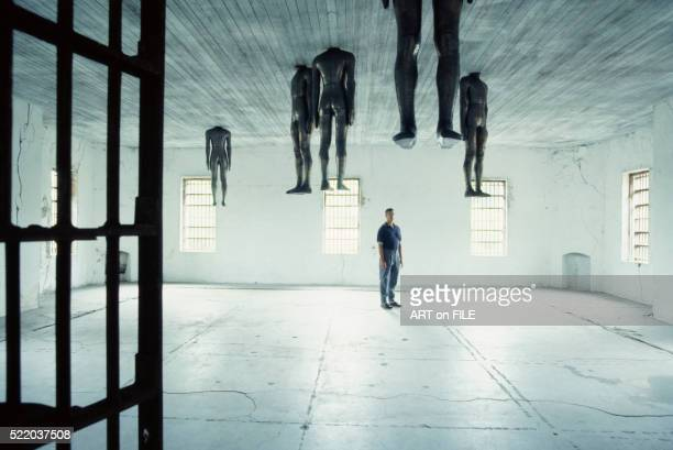 detail of room with levitated lead figures from untitled by antony gormley - antony gormley stock pictures, royalty-free photos & images