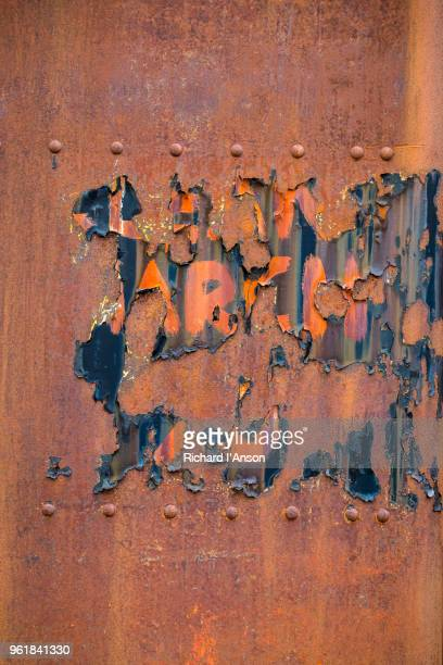 detail of rusted oil tank at abandoned whaling station - rust colored stock photos and pictures