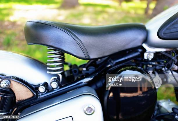 detail of saddle of royal enfield classic 500 motorcycle - indian royal enfield stock pictures, royalty-free photos & images