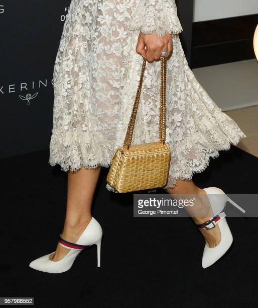 A detail of Salma Hayek's shoes and purse at Kering Women in Motion photocall during the 71st annual Cannes Film Festival at Majestic Hotel on May 13...