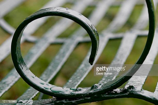 detail of scrolled metal on garden bench - scrollen stock pictures, royalty-free photos & images
