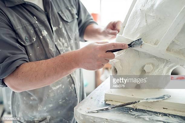 Detail of Sculptor Modeling Plaster Work