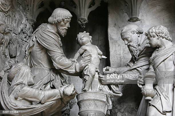 detail of sculpture in chartres cathedral - circumcision stock photos and pictures