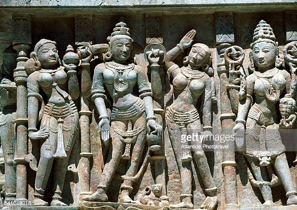 detail of sculpture on adishvara temple - palitana stock photos and pictures