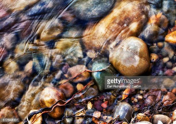 Detail of shallow water with pebbles