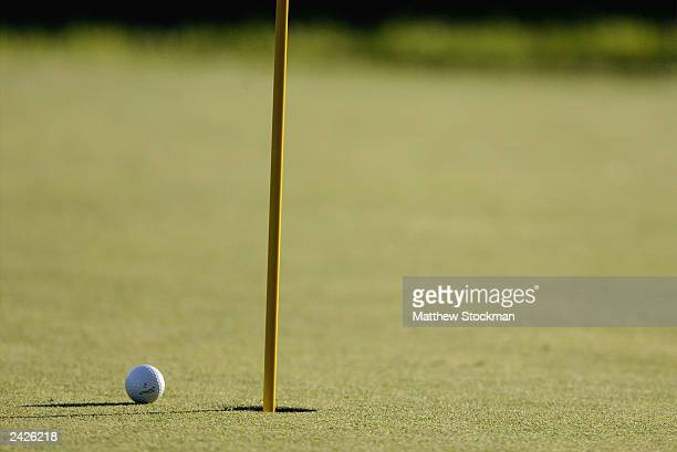 Detail of Shaun Micheel of the USA's ball inches from the 18th hole before he putts in to win the 85th PGA Championship at Oak Hill Country Club on...