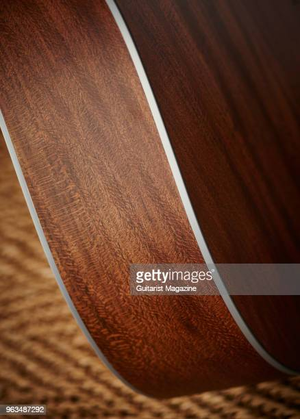 Detail of side and silver acrylic binding on a Martin 16 Series electroacoustic guitar taken on April 25 2017