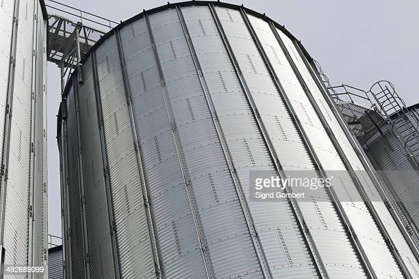 detail of silver silos in port - basel port stock photos and pictures